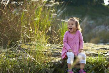 lovely little asian girl outdoor