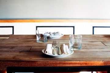 Place Setting on Wooden Table in Urban Restaurant