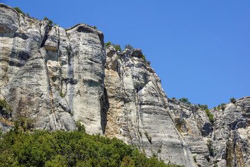 vertical mountain . Rock climbing the steep cliffs of the mountains .