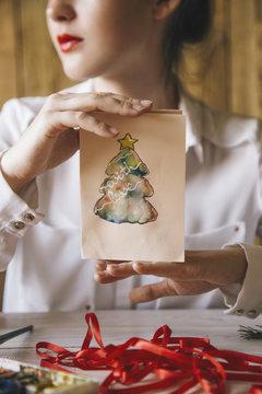 Woman holding Christmas card