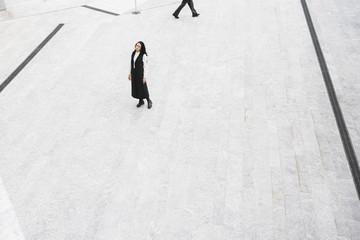 Stylish fashion woman in abstract urban area