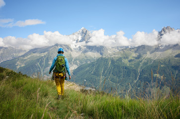 Woman wearing mountain equipment hiking in the Alps