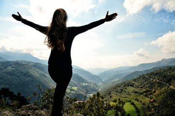 Woman on the top of a mountain