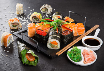 Japanese sushi set on a rustic dark background.