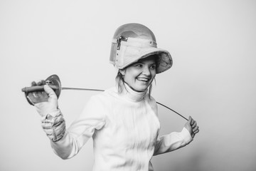 Smiling female fencer