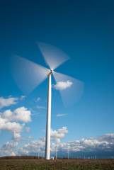 Industrial Wind Turbine Green Energy Generation on Wind Farm With Clear Blue Sky Ontario Canada