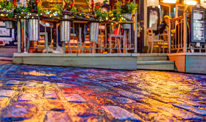 Colorful cobblestone street during blue hour by lower old town street Rue Sous Fort with restaurant
