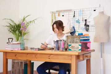 a young woman creating a handmade bag