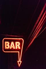 Minimalist BAR sign at night
