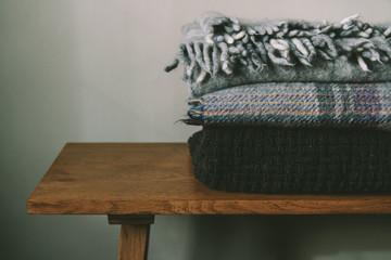 Cosy blankets on an oak bench