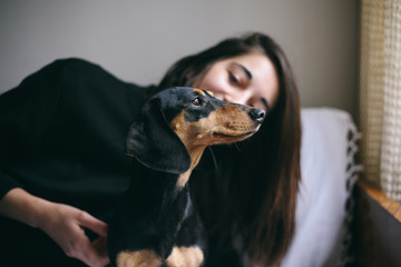 Woman and her small black dog