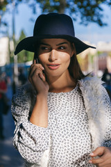 Cute Trendy Woman Talking By Phone in the Street