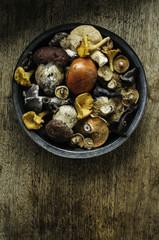 Food still life mushrooms on wooden table.