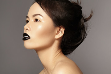 Perfect asian model with fashion make-up and hairstyle. Beauty halloween style with black lips makeup. Catwalk visage