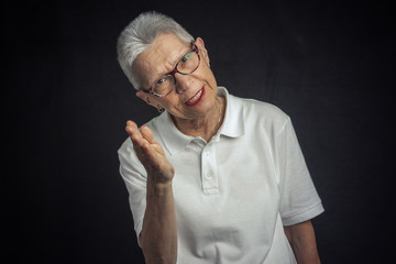 Silly senior lady having fun playing that she's mad, giving a fake reproach