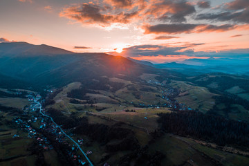Aerial view of the village in the Carpathian mountains on the Sunset