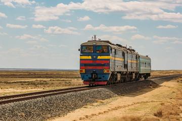 Locomotive train is passing through desert