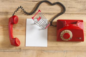 Retro rotary telephone on wood table