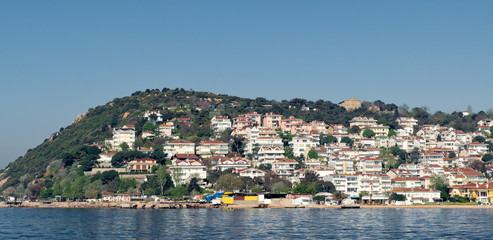 View of Kinaliada island from the sea with summer houses. One of four islands named Princes Islands in the Sea of Marmara near Istanbul