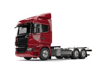 Modern dark red heavy transport truck without a trailer