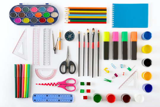 Set of school supplies on white background. Paint, pencils, notepad, brushes, scissors.