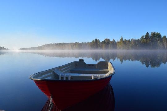 Red boat & blue lake
