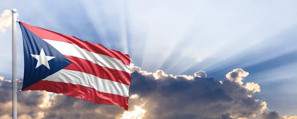 Puerto Rico flag on blue sky. 3d illustration