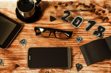 phone. technologies. wooden background. paper is black. office glasses.2018