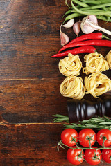 raw tagliatelle on a wooden background