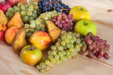 Spoed Fotobehang Voorgerecht autumnal fruit still life on rustic wooden table background