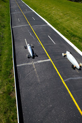 Two cars competing in a Soap Box Derby