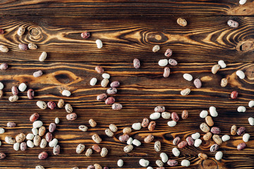 Beans on a wooden background are full of protein and vitamins