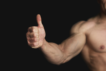 Strong Athletic Man Showing Big Thumb