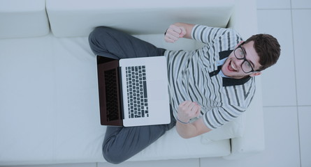 Happy young man using his laptop, Close up.