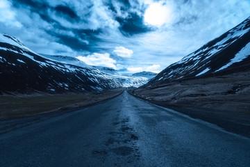 Moonlit road in Sudureyri, Westfjords, Iceland