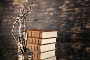 Justice statue and book.