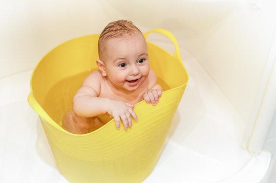 Bathing baby watching interrogatively
