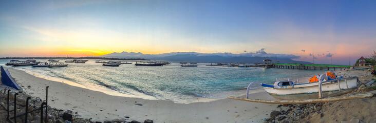 Panorama of Beautiful sunrise with natural colorful sky at Gili Travangan island's port