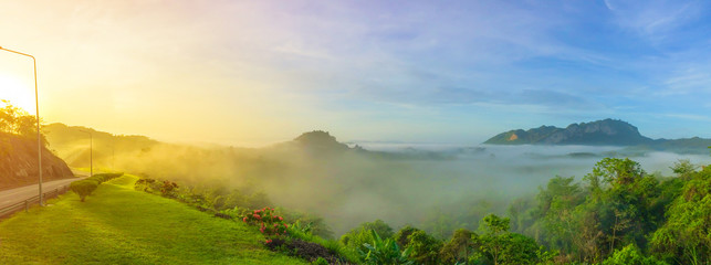 A misty morning before sunrise. .Panorama of road on the Ratchaprapha Dam, Surat Thani province,Thailand