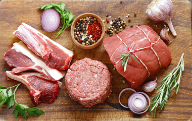 Door stickers Meat Organic raw meat on a wooden table