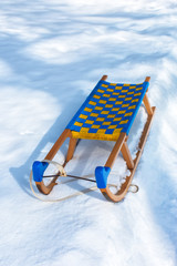 Wooden sledge in winter snow