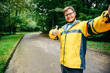 man in sport wear taking selfie in the park