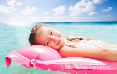 Cute 10 years old girl relaxing on sea resort