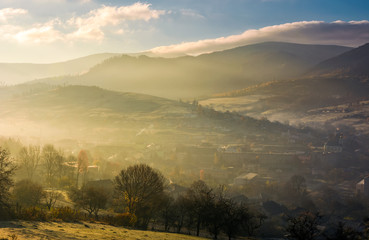 foggy sunrise over the village in valley. gorgeous countryside landscape in autumn