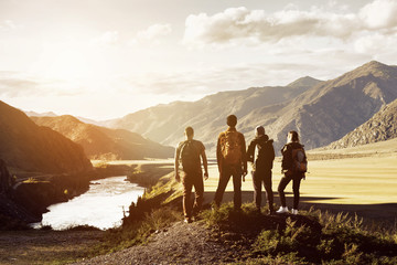 Group four people mountains travel concept