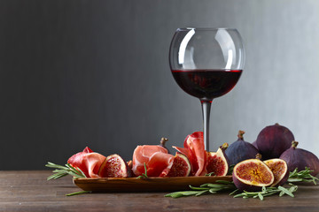 Prosciutto with figs, red wine and rosemary.