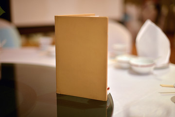 Blank book cover on dining table in wedding ceremony