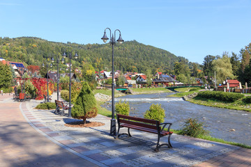 Polish Spa Szczawnica in autumn. Promenade on stream Grajcarek