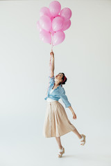 asian woman holding balloons