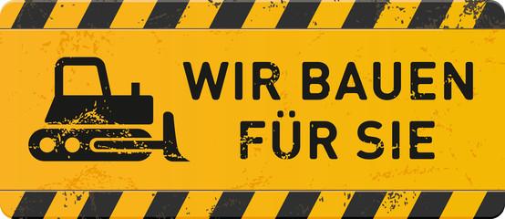 gelbes Schild Wir bauen für Sie mit Planierraupe-Icon